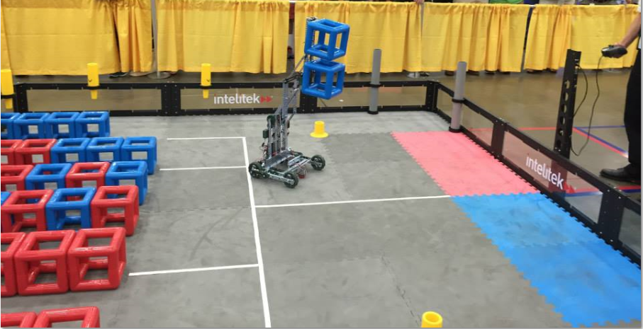Team 126's robot carrying two cubes to the scoring zone